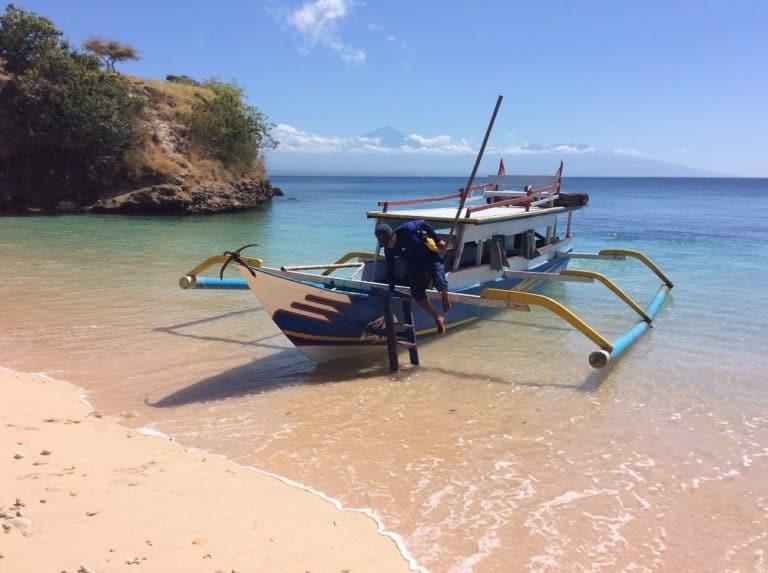 testimony-boat-beach-lombok-indonesia